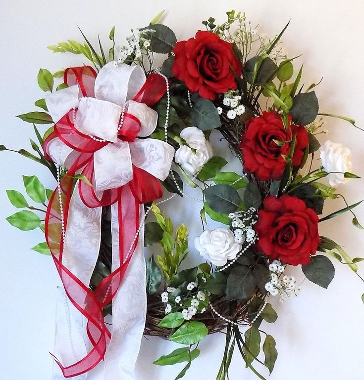 For sale is an oval grapevine Christmas wreath with bright red & white roses, greenery, white baby's breath & a small string of white pearl beads. Also has a double bow of white pattern ribbon & shear red ribbon. | eBay!