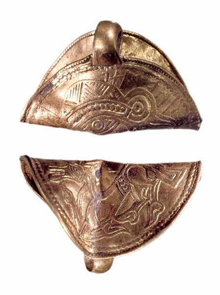 Gold bracteate with runes. The runes are to be read from left to right, on the left is the common magic word alu. Dated to Late Scandinavian Iron Age (AD 400-1050).