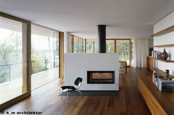 White see-through stove acting as living/dining room divider