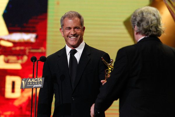 Mel Gibson congratulates George Miller on winning an AACTA Award during the 5th AACTA Awards Presented by Presto at The Star on December 9, 2015 in Sydney, Australia