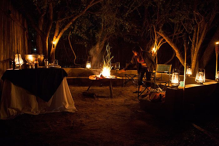 Emma setting up a surprise Cubs Den 'braai' for her kids. Photograph by Caitlin Fay Smith