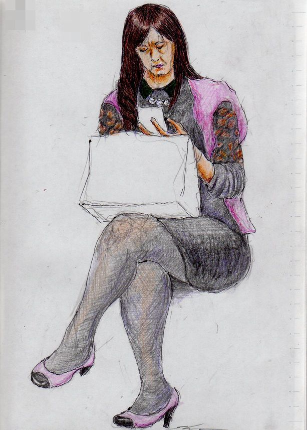 This is a sketch of a woman was sitting with crossed legs I drew on the train.