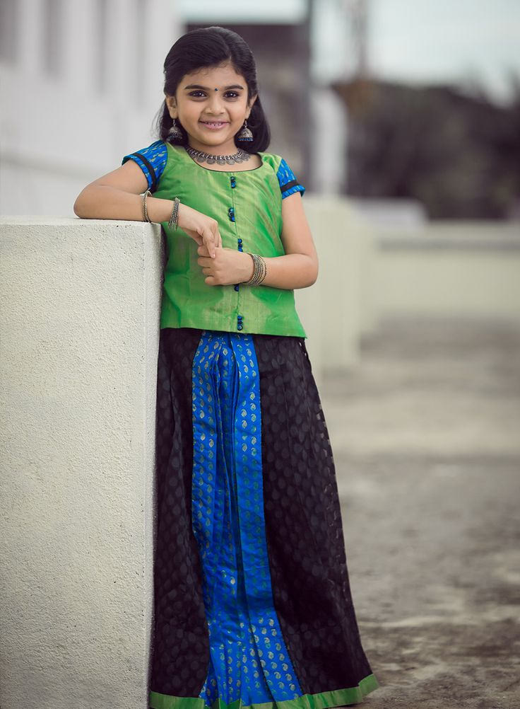 Doll up your daughter in this pleated black banaras net skirt added with a touch of pure silk.