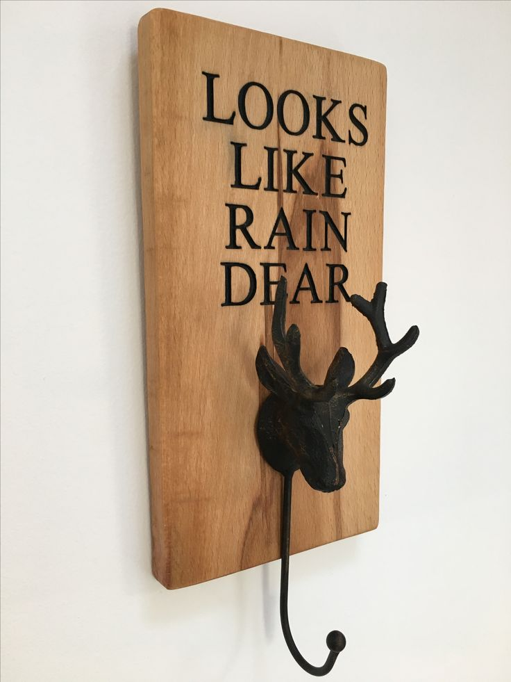 Hand crafted solid Ash wood with cast iron stag's head hook. Visit www.craftsandgiraffes.co.uk