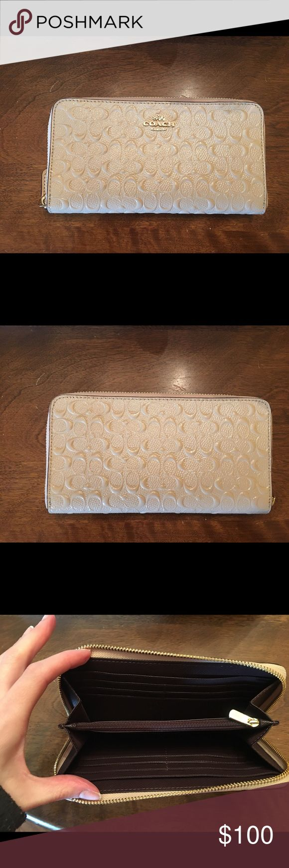 Authentic Coach Wallet Authentic Coach wallet cream color matches the Coach bag also listed. Only used 2 times practically brand new. Coach Bags Wallets