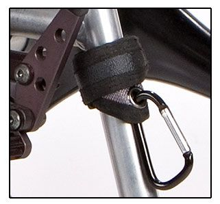 Wheelchair Bags and Accessories, including: The No-Slip Grip-Clip is a wrap around strap with a strong aluminum spring activated caribiner clip that helps you carry stuff on the front tubing of your wheelchair with-out sliding down your wheelchairs frame.