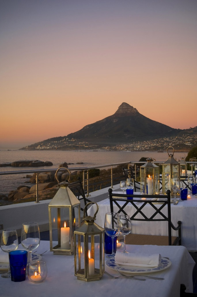 During the summer months at The Twelve Apostles, guests enjoy dining on the open Azure terrace with views of the ocean and Lion's Head. #Restaurants #Hotels #CapeTown
