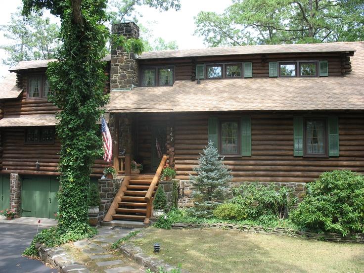 large log cabin restored with deck restoration plus