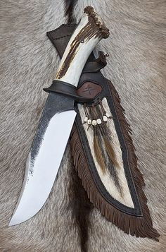 Custom Handmade Knives - Tomas Rucker. This is nice, antler handle, whitetail hide, fringed leather. I think I want one !