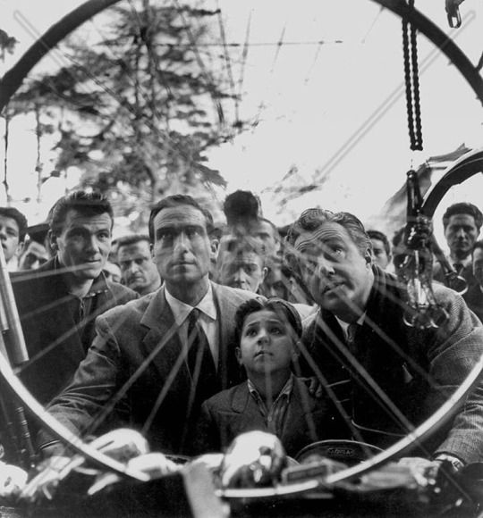Lamberto Maggiorani, Enzo Staiola, and Vittorio De Sica while filming BICYCLE THIEVES (1948). The Criterion Collection