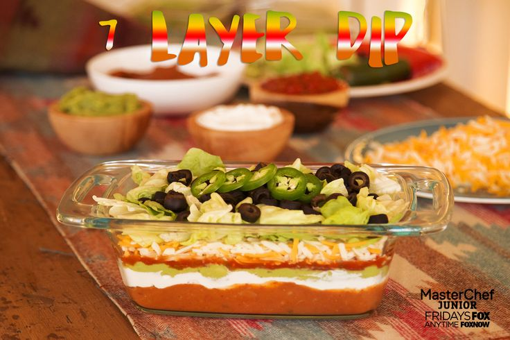 Seven Layer Dip – simple, delicious, and everyone loves it. Plus, aren't those layers pretty? Use a glass serving dish like we did so you can show them off. This is quick appetizer to make if you have all your ingredients at the ready – so many colors!