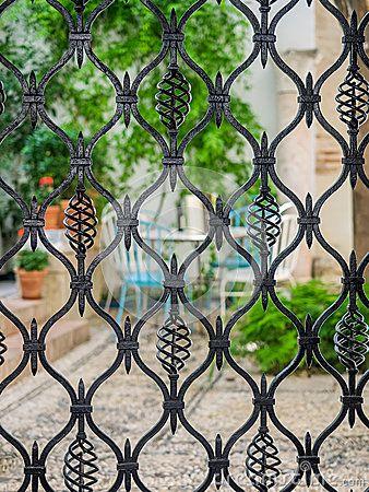 Detail of wrought iron gate. Courtyard of Cordoba, Spain