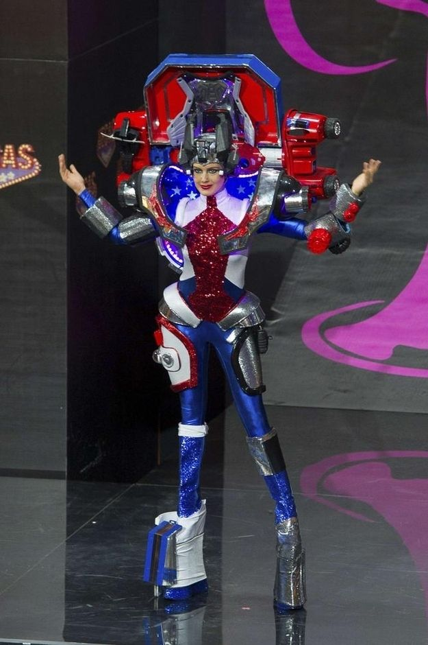 Most of the other countries went with a sexy, carnival, or ballroom theme.. Miss USA costume for Miss Universe is a  Transformer! USA USA USA! haha! Awesome.