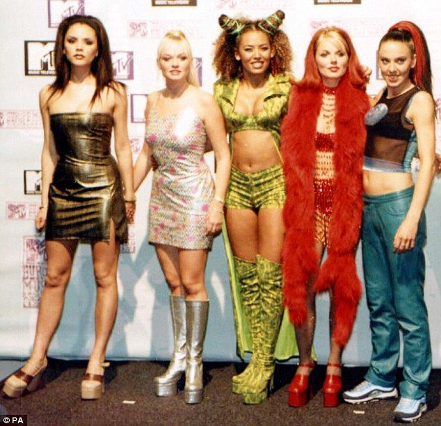 Girl Power! Victoria with Emma Bunton, Melanie Brown, Geri Halliwell and Melanie Chisholm in the height of the Spice Girls' fame