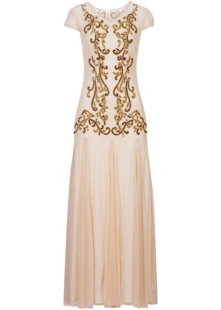 Pro luxusní chvíle! Večerní šaty s náročnou výšivkou na přední straně a na ramenech. Sukně z lehce splývavého tylu s neprůhlednou podšívkou. Délka ve vel. 38 cca 146 cm. Vrchový materiál: 100% polyester; Podšívka: 100% polyester