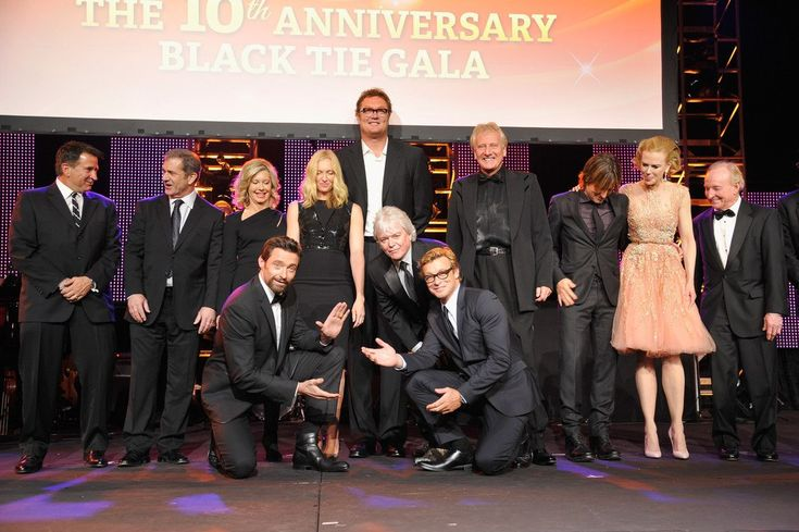 2013 G'Day USA Los Angeles Black Tie Gala - Inside (L-R) Past honorees Anthony Lapaglia, Mel Gibson, Olivia Newton-John, Hugh Jackman, Toni Collette, Luc Longley, Russell Hitchcock, Simon Baker,Graham Russell, Keith Urban, Nicole Kidman, Rod Laver and Roy Emerson onstage during the 2013 G'Day USA Los Angeles Black Tie Gala at JW Marriott Los Angeles at L.A. LIVE on January 12, 2013 in Los Angeles, California.