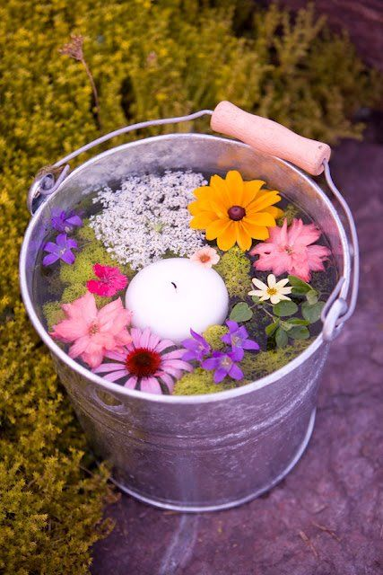 Pretty garden party idea...Bucket filled with warter an floating candles an flowers! on the mark with this one:)
