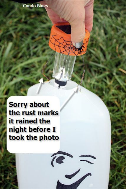 Condo Blues: Make Solar Milk Jug Ghosts - use solar lights from dollar store (leave stake on), faces printed out from Martha Stewart, and Outdoor Mod Podge.