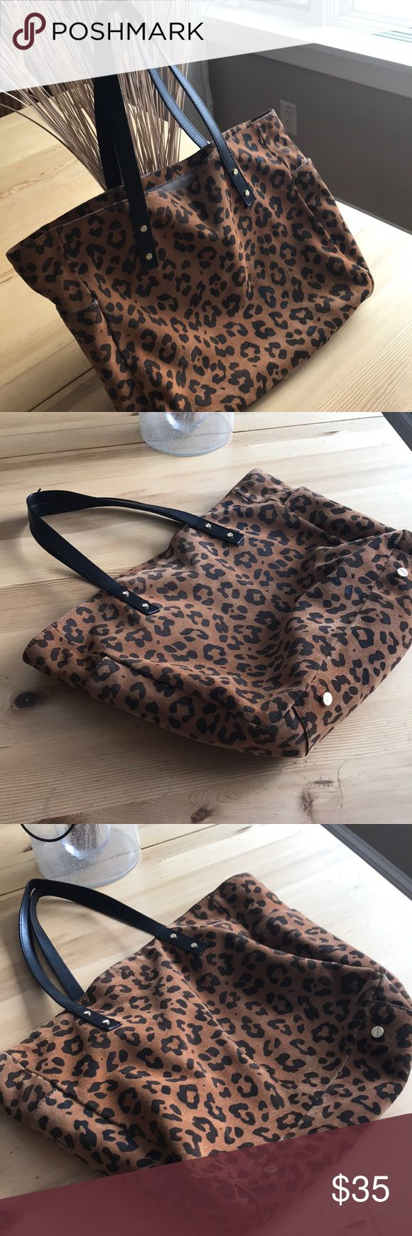 J Crew suede leopard tote bag J Crew suede leather leopard print tote bag! Lined, clean interior! Purchased new retail by me,  and lovingly cared for and enjoyed. No tears or issues on exterior. A few faded area on back of bag, done wear on handles as detailed in pictures. Such a great bag, loads of life left!! Offers and bundles welcome! Thanks for looking! J. Crew Bags Totes