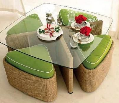 Wedge-shaped upholstered ottomans provide storage, seating, AND hide underneath the table when not in use.  If you use a bright color and a glass table top, it even adds a pop of color to your apartment!