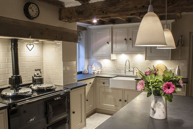 Country kitchen with wooden beams, range cooker, painted cupboards and butler sink ~ lovingly repinned by www.skipperwoodho... Handmade Furniture - http://amzn.to/2iwpdj4