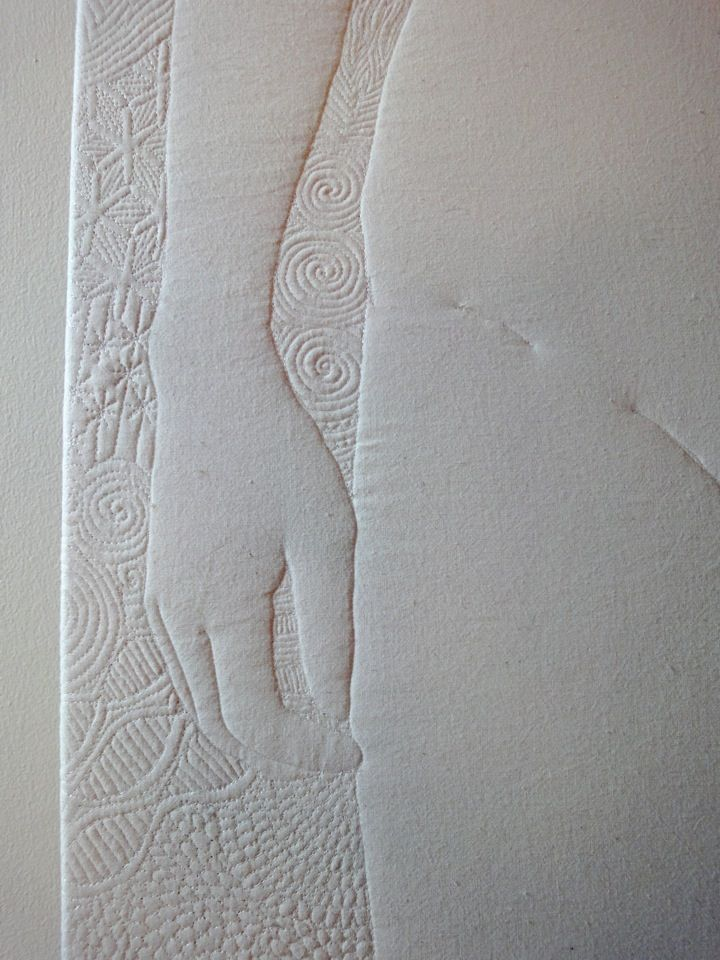 a detail from Air/Nude the 4th in a series of elements quilts by Nina Paley