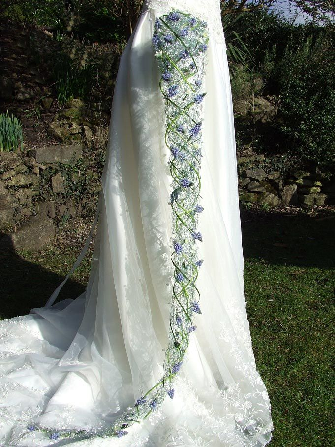 Beautifully elegant long wired cascade wedding bouquet with blue muscari and embellished with crystals and beads is perfect for a bride who is looking for a unique, individually styled bridal bouquet. www.blackbaccara.co.uk