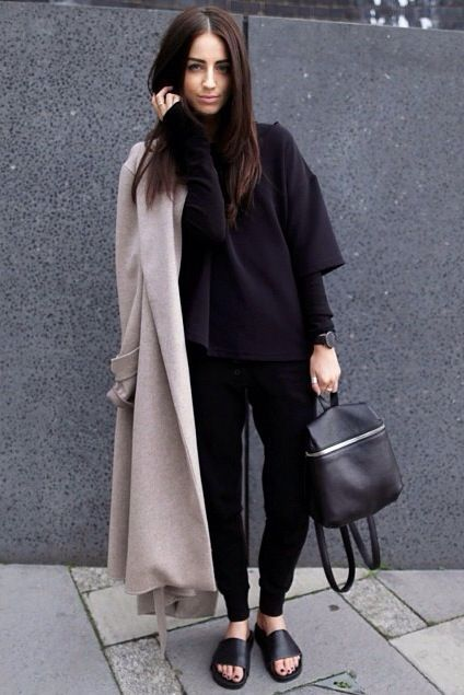 Shop this look on Lookastic:  http://lookastic.com/women/looks/turtleneck-coat-watch-backpack-sweatpants-flat-sandals/9111  — Black Turtleneck  — Beige Coat  — Black Leather Watch  — Black Leather Backpack  — Black Sweatpants  — Black Leather Flat Sandals