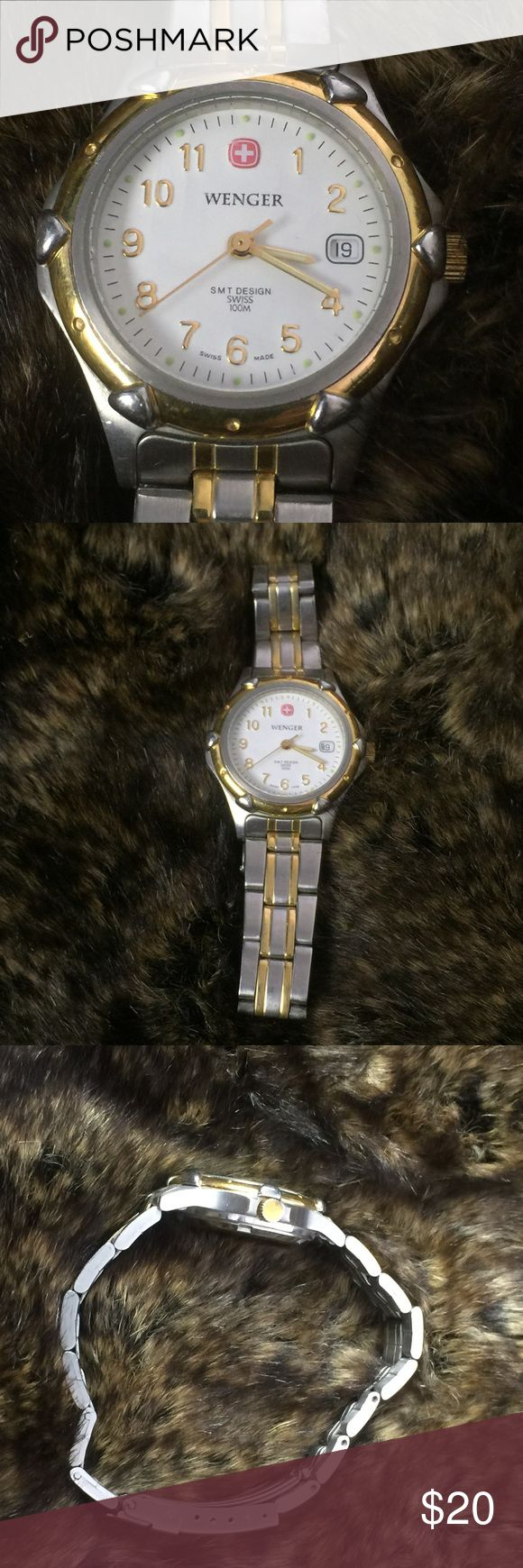 """Ladies Wenger Silver w Gold Band Watch w/ Calendar Band adjusted to fit approx. 6.75""""-7"""" wrist but removed links will be included.  Swiss made, quartz.  Stainless steel.  Needs new battery.  Not worn a ton but does Show wear.  Scratch resistant crystal, water resistant(can wear in shower, washing hands.). Safety latch closure.  Lots of life left in this watch!  Smoke free, pet free. Wenger Accessories Watches"""