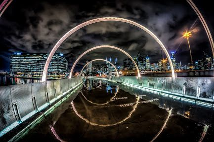 Russell Charters - Google+ reflections on the Webb Bridge at Docklands Melbourne Australia Follow the link to see more of Russell's fantastic work.