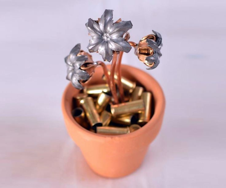 Bullet Bouquets. No better way to call them than that. And just as cool as these loaded pots of blooms: gung-ho shooter and artist Anthony Zambai saw the idea for them on Reddit less than a week ago. When the Bullet Bouquet was presented on the front pa