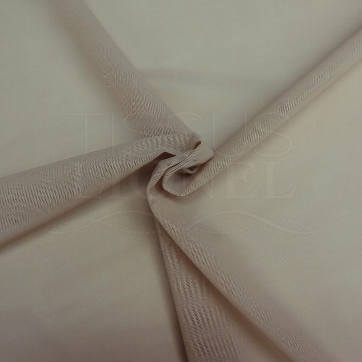 Le tissu lycra gaine chair est un tissu résille très, très épais. Il est extensible dans le deux sens. C'est un tissu facile d'utilisation et très résistant. Il convient parfaitement à la création des gaines. Le tissu lycra gaine chair est également très utilisé pour la confection de costumes et tenus de spectacle.Ce tissu est présenté sur un fond blanc.