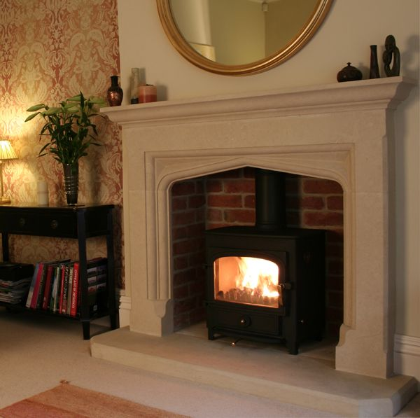The perfect combo. Limestone Belton Style surround with Clearview Stove. The wallpaper by the way is by Laura Ashley. We got that too!