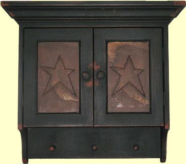 """This Star Cupboard captures the true look and feel of Colonial America, recreating 17th, 18th, and 19th century primitive American country furniture.  It is an authentic design, handmade, then painted with an authentic milk paint color, and finished with a timeworn and aged patina, giving it that original old look.  Measures 26"""" High x 24"""" Wide x 8"""" Deep"""