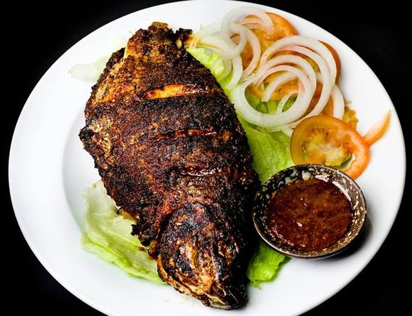 West African restaurant Charcol makes tilapia spicy at Nakamoto space in Plano