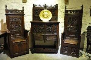 CUPBOARDS - THIS OUTSTANDING LATE MEDIEVAL WALNUT BUFFET IS OF THE HIGHEST QUALITY, THE TOP WITH PIERCED GOTHIC TRACERY FLANKED BY GOTHIC FINIALS, ABOVE FOUR DEEPLY CARVED TRACERY PANELS, THE LOWER SECTION AGAIN WITH TWO DEEPLY CARVED GOTHIC TRACERY DOORS FLANKE