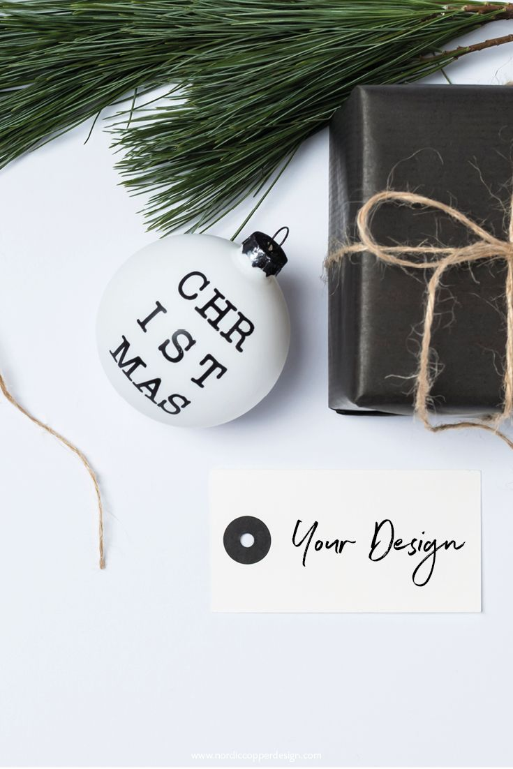 Minimal Scandinavian style flat lay in neutral and toned down colors. Grab this styled stock photo including a blank gift tag to get your shop, blog, website and social media account ready for Christmas.