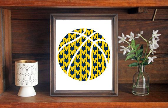This colorful University of Michigan Wolverines Basketball print is an original pattern, designed with the University of Michigan Wolverines colors and symbols in mind. This print come in a variety of sizes (please see drop down menu on the right).  This print can come with or without the words, Michigan Wolverines (please see drop down menu on the right).  This unique University of Michigan Wolverines Basketball print looks great by itself, or on a gallery wall with other prints. It would…