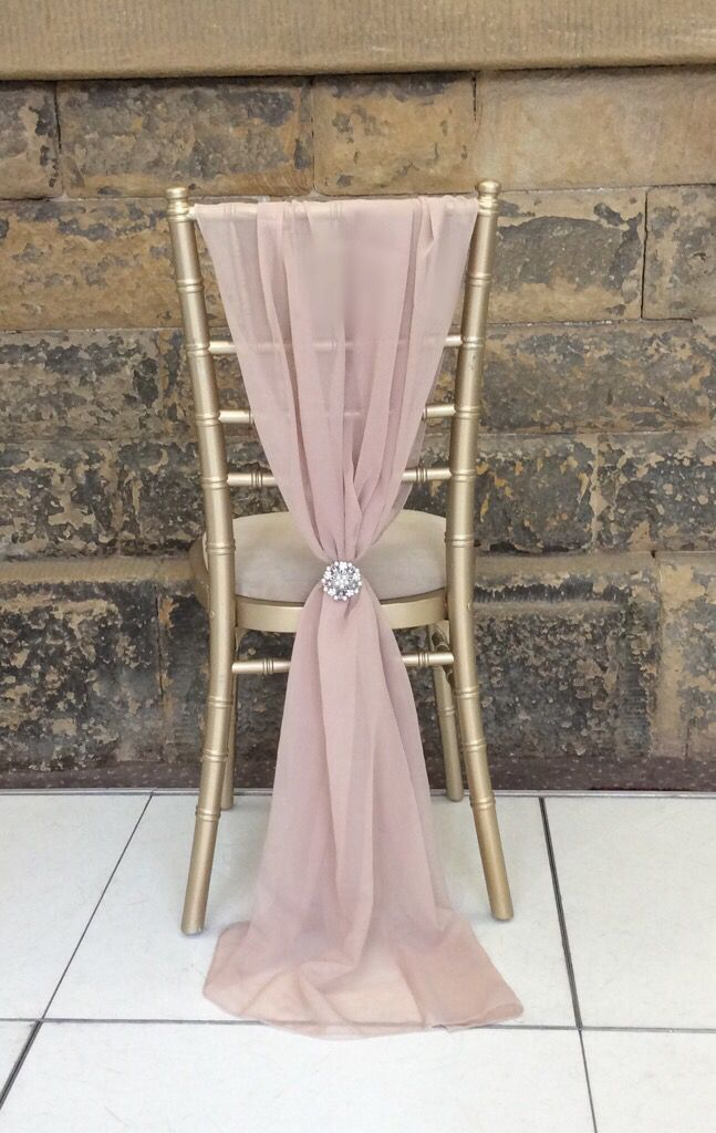 Our blush pink chiffon chair wraps look so romantic for an elegant wedding by Debonair Venue Styling.