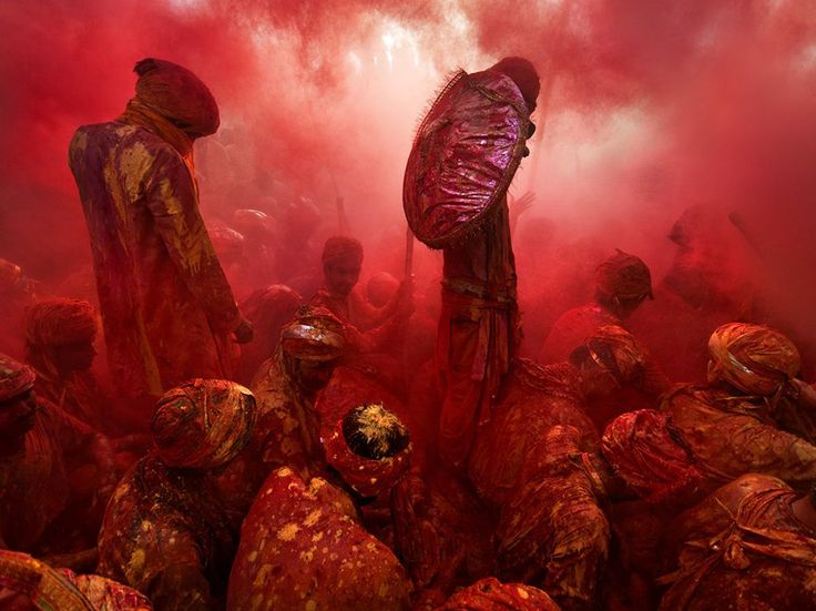 Picture of people covered in red dust for Holi celebrations in India