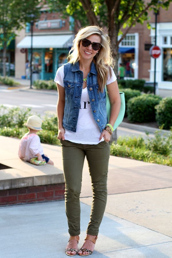 Choose a blue denim vest and olive skinny jeans for a casual level of dress. Nude leopard leather flat sandals will give your look an on-trend feel.   Shop this look on Lookastic: https://lookastic.com/women/looks/vest-v-neck-t-shirt-skinny-jeans-flat-sandals-tote-bag-sunglasses-necklace-bracelet/12347   — Dark Brown Leopard Sunglasses  — Green-Yellow Necklace  — Blue Denim Vest  — Mint Leather Tote Bag  — White and Black Print V-neck T-shirt  — Green-Yellow Bracelet  — Olive Skinny Jeans…