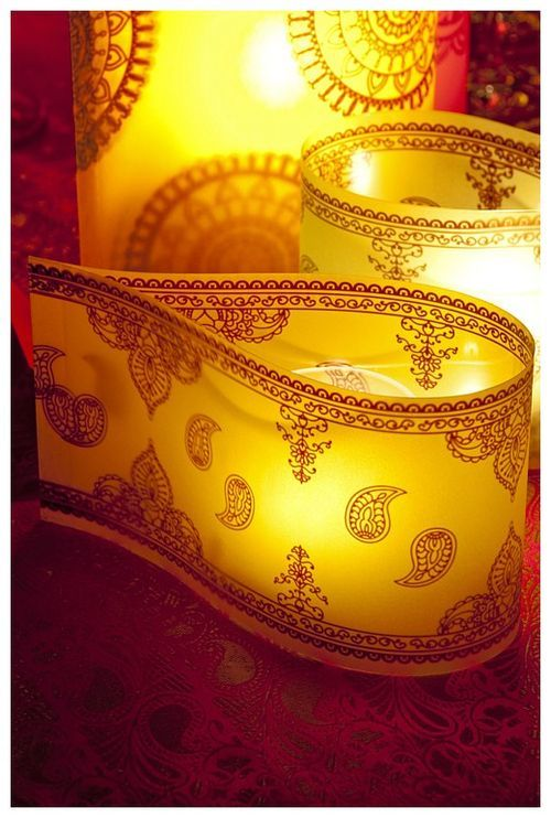 acetate papers were pinched into glowing paisley-like shapes, all surrounding standard glass cylinders of varying size that held candles.