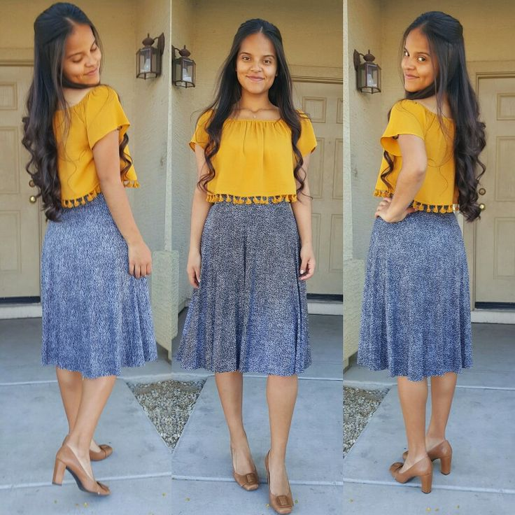 Love the top and skirt. Together with the tan heels look good