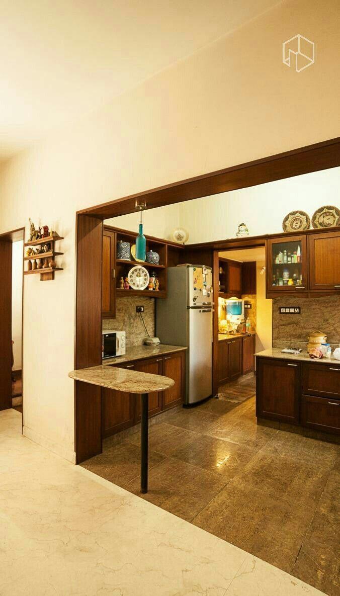 Indian Interior: Open floor plan, polished tile, dark wood