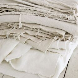 Use this method to bleach a stiff drop cloth and turn it into yards of soft, beautiful fabric for use in home decor and crafts.