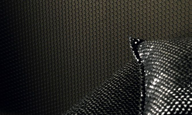 Elitis Visa Versus.  Inspired by a sole of a shoe, Versus wallpaper create  unique textured wall.  Perfect wallpaper for a man cave!