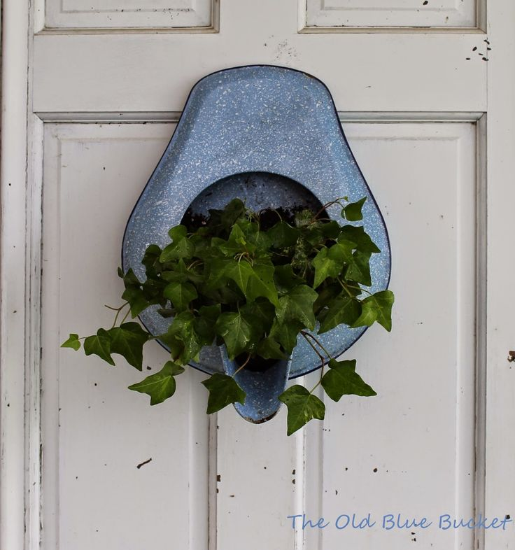 Love all of the repurposed decor and creativity in this potting shed. The Old Blue Bucket: Welcome To My Potting Shed ~