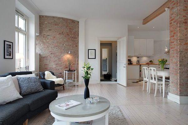 Широко используются в скандинавском стиле кирпич и бетон — простые и понятные материалы, не раздражающие взгляд и оттеняющие белоснежный интерьер.