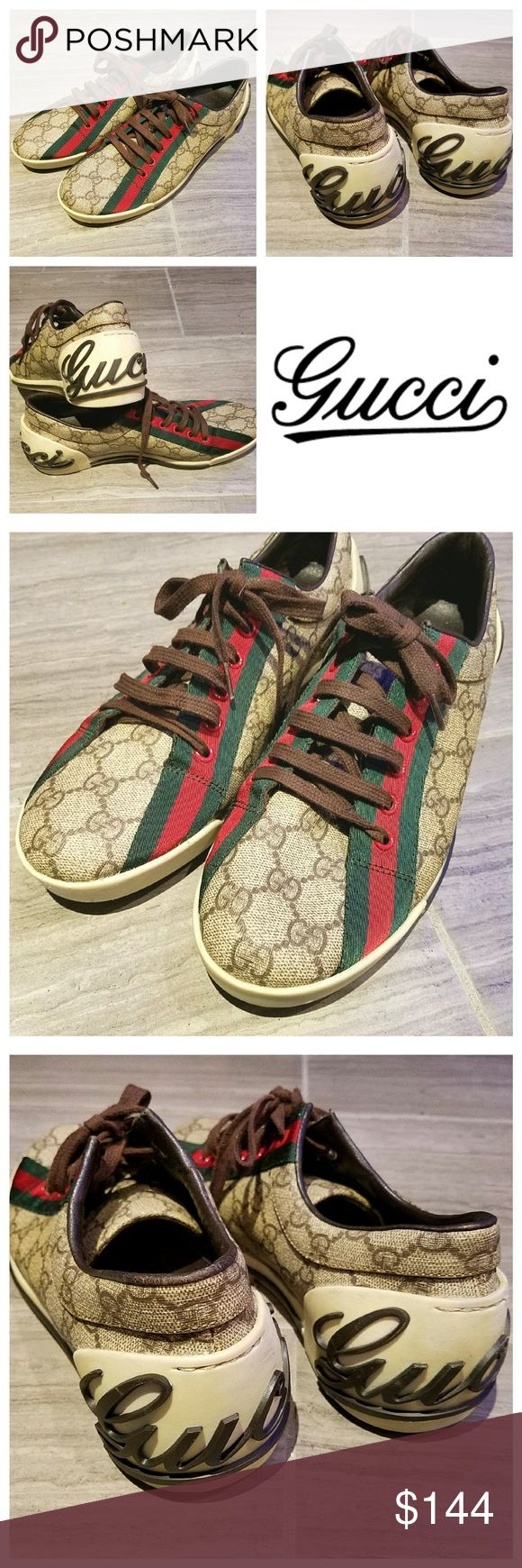 RETRO AUTHENTIC GUCCI MONOGRAM LOGO SNEAKERS Excellent condition, only wore a couple times. AUTHENTIC GUCCI MONOGRAM SNEAKERS in classic 2 tone brown with the red & green racing stripe and script Gucci signature on back. Very minor wear, 2 marker spots on bitten of one shoe, minor scuffs, minor discoloring. No tears or holes. Guaranteed authentic. No box. Size 38.5 Gucci Shoes Sneakers