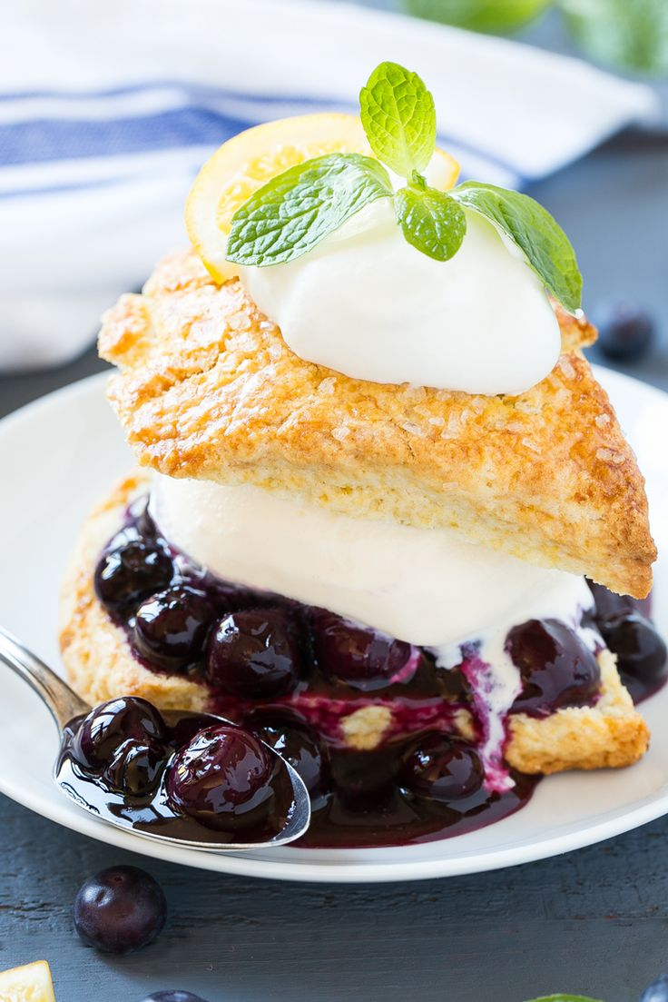 This recipe for blueberry shortcake is vanilla ice cream and homemade blueberry sauce sandwiched between lemon shortcake & finished off with whipped cream.